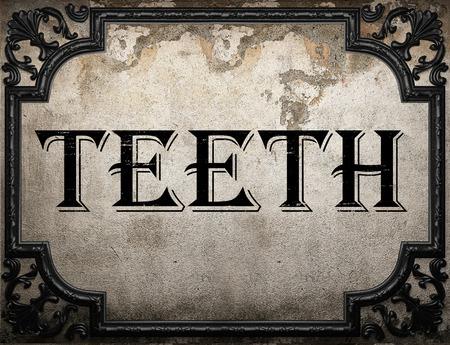 dirty teeth: teeth word on concrete wall