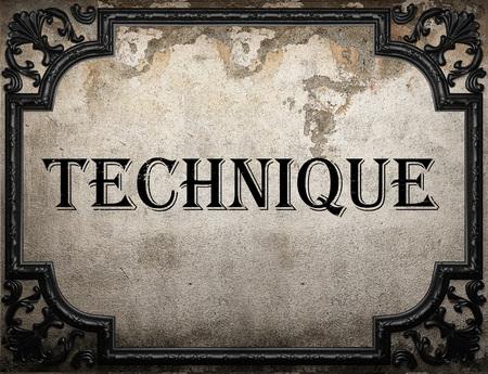 palabra técnica en la pared de hormigón Foto de archivo