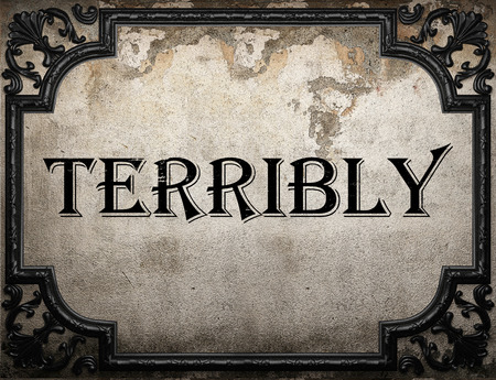 terribly: terribly word on concrete wall