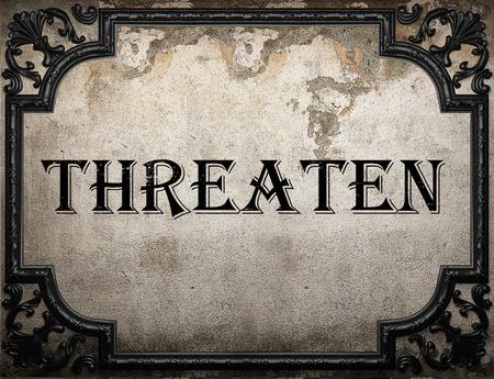 threaten: threaten word on concrete wall Stock Photo