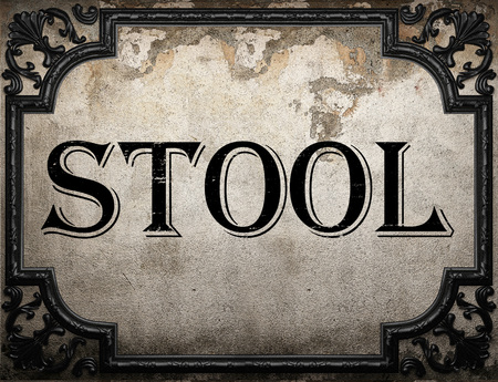 stool: stool word on concrete wall