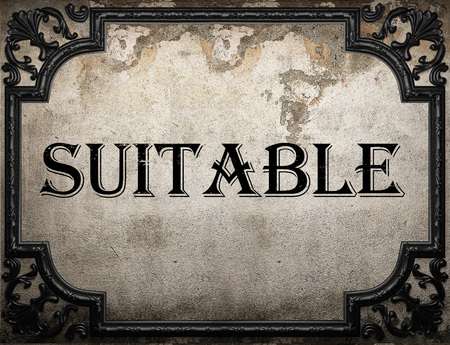 suitable: suitable word on concrete wall