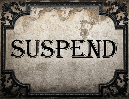 suspend: suspend word on concrete wall Stock Photo