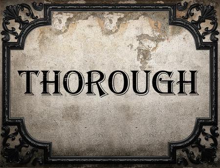 thorough: thorough word on concrete wall