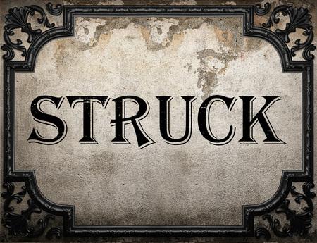 struck: struck word on concrete wall Stock Photo