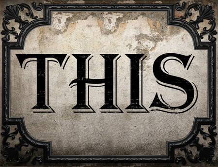 this: this word on concrete wall Stock Photo