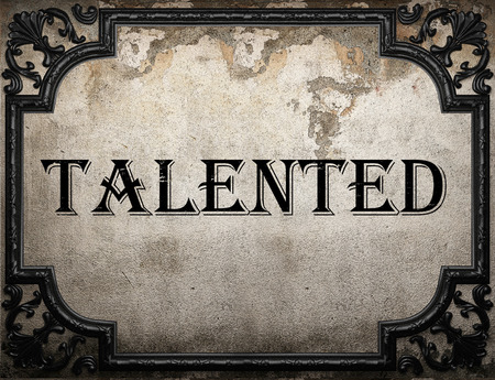 talented: talented word on concrete wall