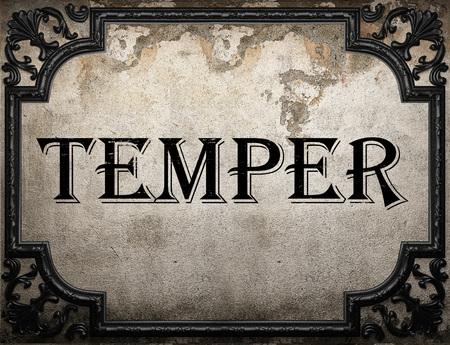 temper: temper word on concrete wall