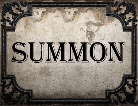 summon: summon word on concrete wall