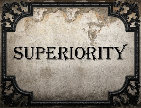 the superiority: superiority word on concrete wall Stock Photo