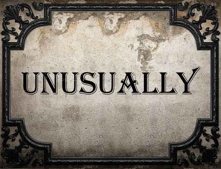 unusually: unusually word on concrete wall Stock Photo
