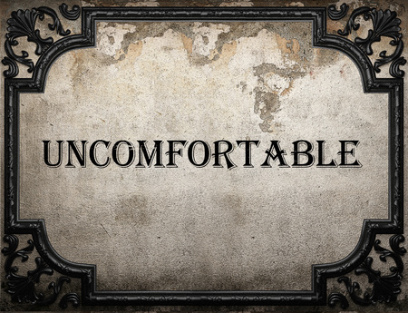 uncomfortable: uncomfortable word on concrete wall