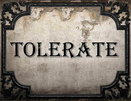 tolerate: tolerate word on concrete wall