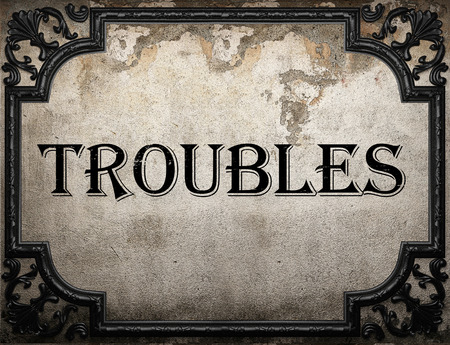 troubles: troubles word on concrete wall