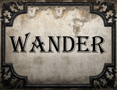 wander: wander word on concrete wall Stock Photo