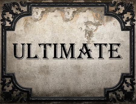 ultimate: ultimate word on concrete wall Stock Photo