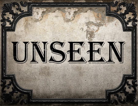 unseen: unseen word on concrete wall