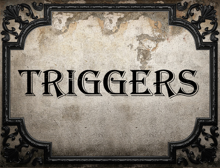 triggers: triggers word on concrete wall Stock Photo