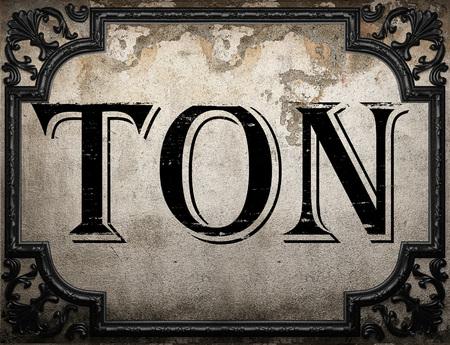 ton: ton word on concrete wall