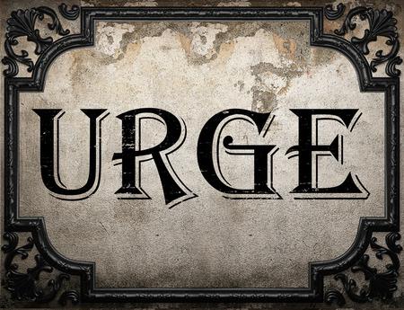 urge: urge word on concrete wall