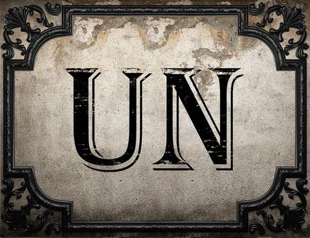un: un word on concrete wall Stock Photo
