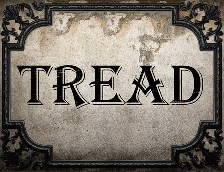 tread: tread word on concrete wall