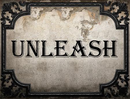 unleash: unleash word on concrete wall