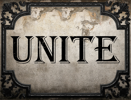 unite word on concrete wall