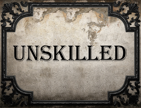 unskilled: unskilled word on concrete wall
