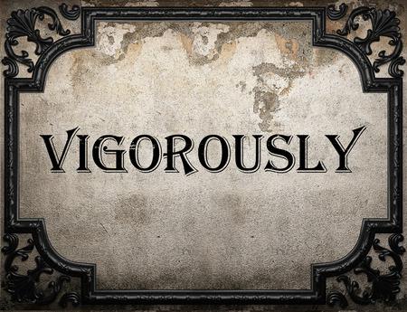 vigorously: vigorously word on concrete wall