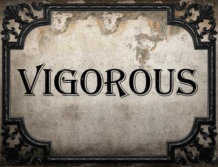 vigorous: vigorous word on concrete wall Stock Photo
