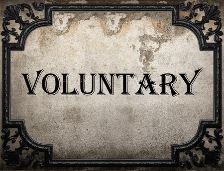 voluntary: voluntary word on concrete wall Stock Photo