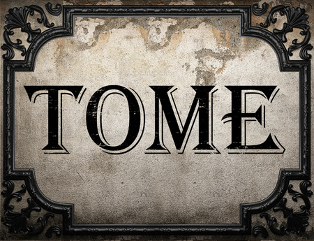 tome: tome word on concrete wall