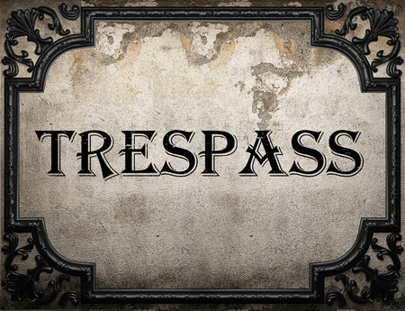 trespass: trespass word on concrete wall