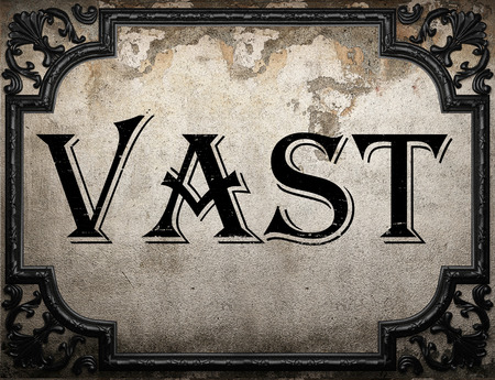 vast: vast word on concrete wall Stock Photo