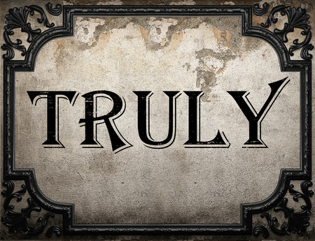 truly: truly word on concrete wall Stock Photo