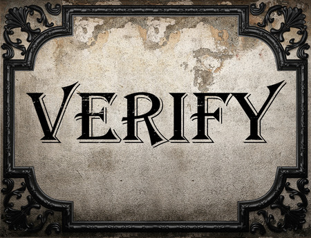verify: verify word on concrete wall