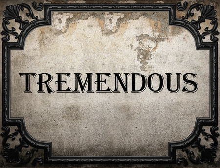 tremendous: tremendous word on concrete wall