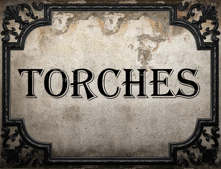 torches: torches word on concrete wall