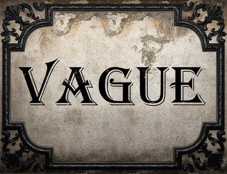 vague: vague word on concrete wall Stock Photo
