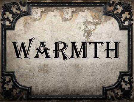 the warmth: warmth word on concrete wall