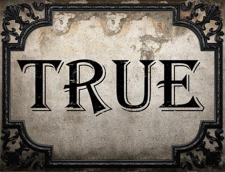 true: true word on concrete wall