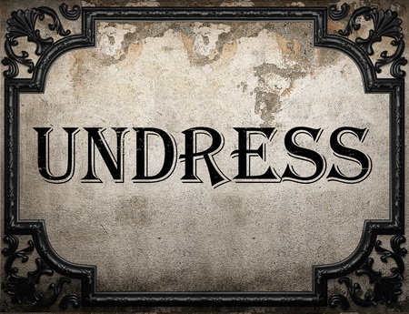 undress: undress word on concrete wall