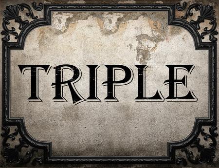 triple: triple word on concrete wall