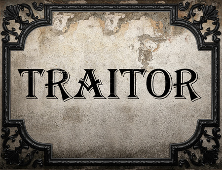 traitor: traitor word on concrete wall