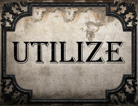 utilize: utilize word on concrete wall