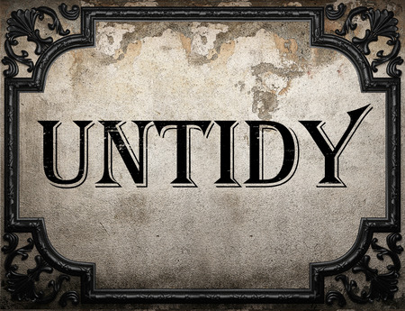 untidy: untidy word on concrete wall