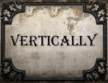 vertically: vertically word on concrete wall Stock Photo