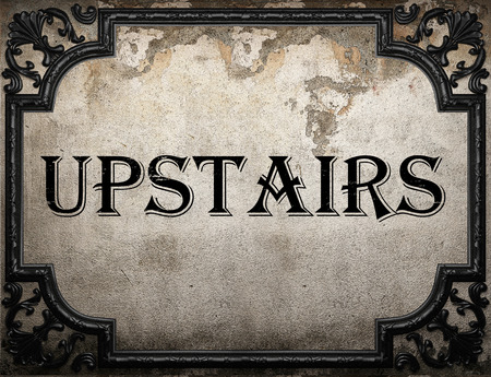 upstairs: upstairs word on concrete wall Stock Photo