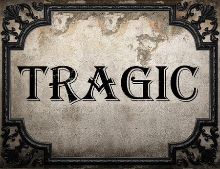 tragic: tragic word on concrete wall
